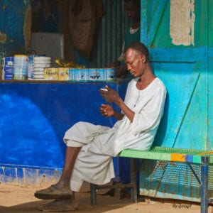 Sudanese man with mobile phone