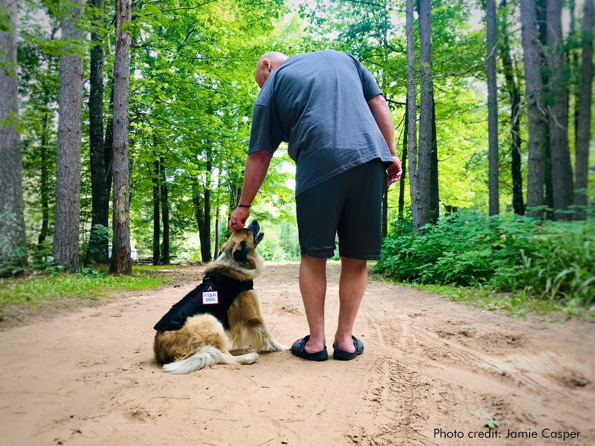 Man with his service dog | Photo credit: Jamie Casper